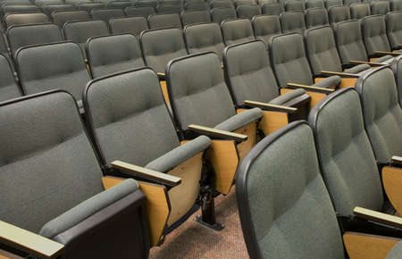 Auditorium seats in a college classrom setting.