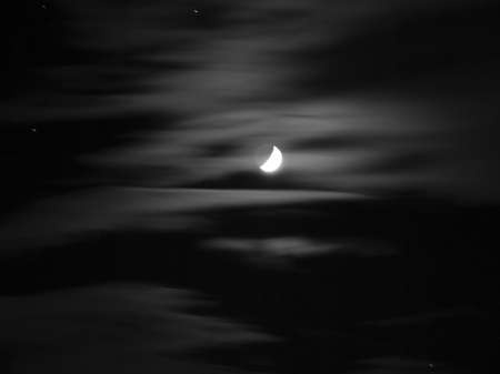 A black and white moon with stars photo