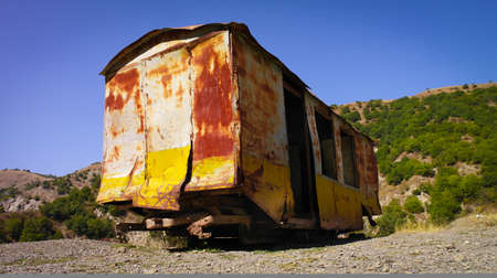 Old rusty abandoned wagon.  An abandoned rusty train wagon left outside in the nature.