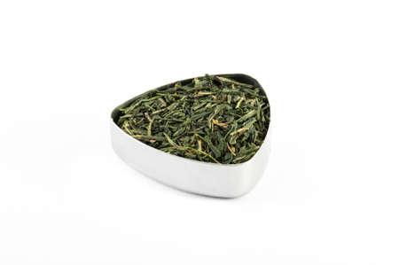 sencha tea: Sencha, bio green tea from Japan in a metal container Stock Photo