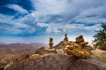 stapled: Stone Pyramids in front of an endless panoramic view in Joshua National Park, California