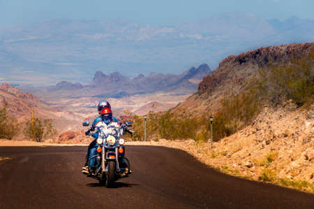 Biker driving on the Highway on legendary Route 66 to Oatman, Arizona.