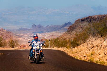 road bike: Biker driving on the Highway on legendary Route 66 to Oatman, Arizona.