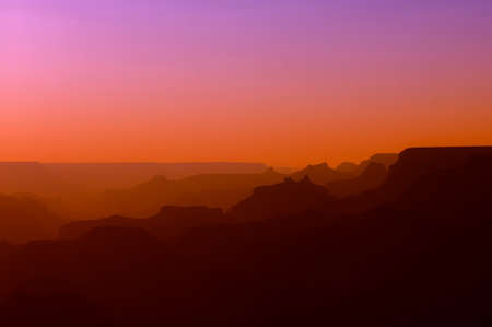 Panoramic View of Grand Canyon in red and purple colors after sunset