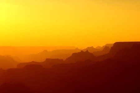 colorado mountains: Panoramic View of Grand Canyon in yellow and red colors after sunset Stock Photo