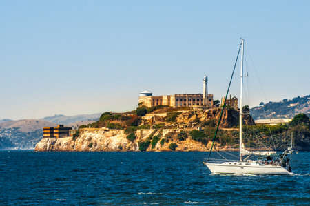 Alcatraz island with prison and yacht in San Francisco bay, California, USA