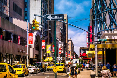 New York City - June 14, 2017: Street scenery at Broadway in Manhattan, NYC. Picture with traffic and cabs and the famous theater and musical ads and billdboards. Area is located near Times Square.