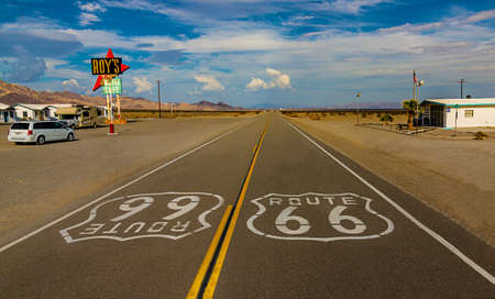 World famous and historic Route 66 signs on road at iconic Roy's Motel and Cafe in Amboy, California 免版税图像 - 108447025