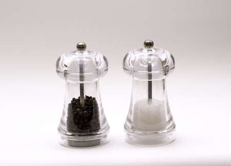 Salt   Pepper shakers on a white backdrop  photo