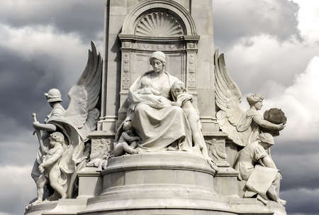 The Victoria Memorial - sculpture in London, placed at the centre of Queen s Gardens in front of Buckingham Palace  The Angel of Charity  Stock Photo - 23434788