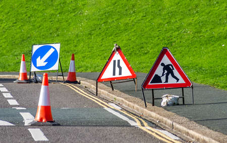 kerb: signs and traffic cones set up on the road