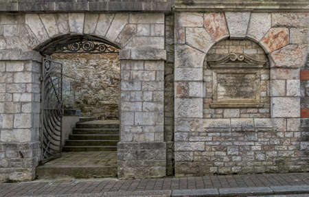 Antique wall with an entrance gate standing on the Ker Street in the historic district of Devonport in Plymouth.UK