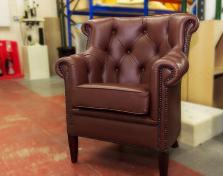 Leather armchair with decorative buttons and nails photo