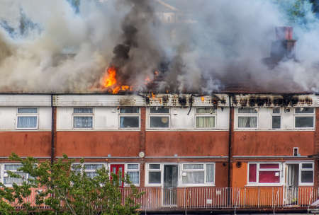 Fire in residential building and rescue. Stock Photo