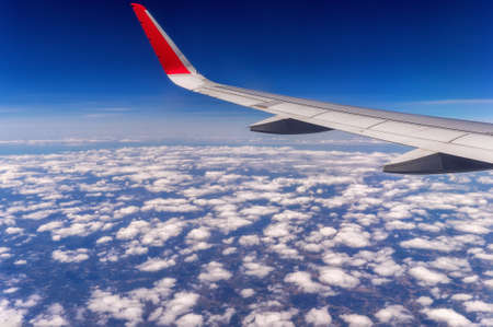 airfoil: Airplane wing above the clouds. Stock Photo