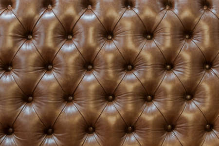 leather background: Upholstery quilted .