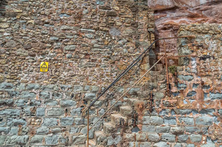 Old stone stairs located in a historic building.
