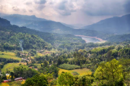 Mountain landscape in Sri Lanka against a cloudy sky. Stock Photo