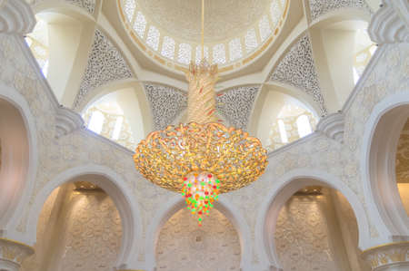 A huge chandelier hanging under the dome of the Sheikh Zayed Grand Mosque