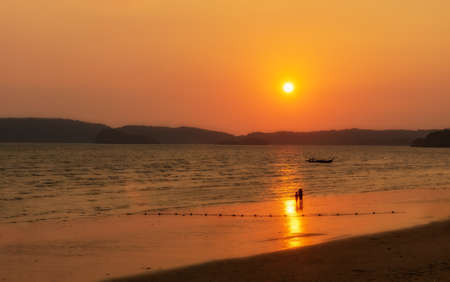 Sunset on the Ao Nang beach in Thailand. Stock Photo