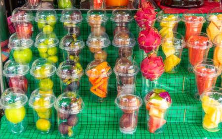 Fresh fruit and vegetables prepared for making fruit cocktails for sale at the Bangkok market.