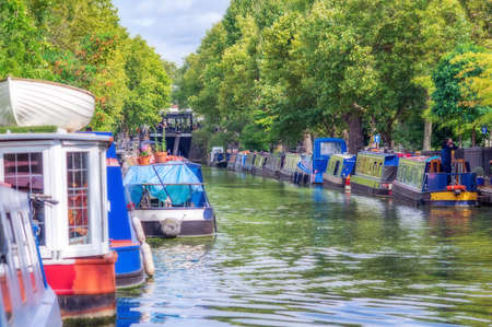 REGENT'S CANAL, one of many London canals with colorful residential boats moored.