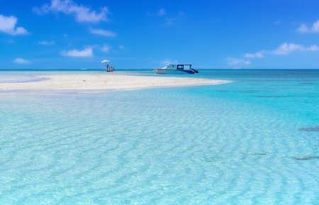 A sandbank umbrella somewhere in the Maldives, all ready for a beach picnic.