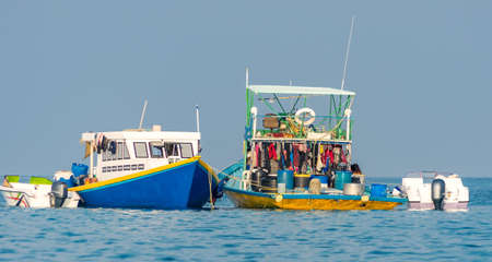 Maldives. Worker boats near the island of Fulidhoo. Stock Photo