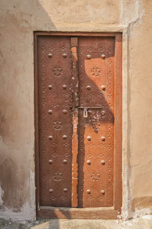 Old brown door photographed somewhere in the old part of Dubai.