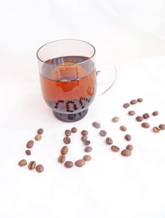coffeebeans: a cup of coffe and coffee-beans Stock Photo