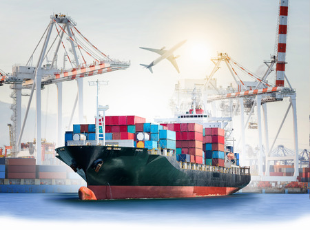 International Container Cargo ship with ports crane bridge in harbor and Cargo plane for logistic import export background and transport industry.