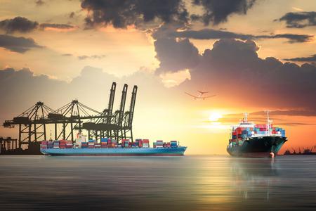 物流・貨物輸送、夕焼け空に港のポート クレーン橋と国際コンテナー貨物船と貨物機の輸送配送 写真素材