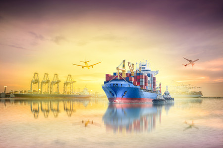 importation: Logistics and transportation of international container cargo ship and cargo plane with ports crane bridge in harbor at sunset sky for logistics import export background and transportation industry.