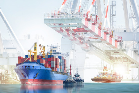 Logistics import export background and transportation industry of international container cargo ship with tugboat on port crane background