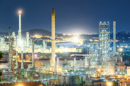 Oil and gas refinery plant at night, Petrochemical factory Stock Photo