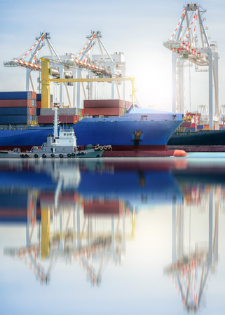 Logistics and transportation of International Container Cargo ship in a harbor with water reflections, Freight Transportation, Shipping, Nautical Vessel Stock Photo