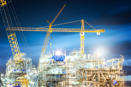 Construction of oil and gas refinery at twilight sky