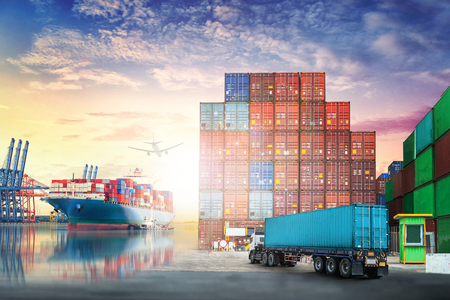 Logistics import export background and transport industry of Container truck and Cargo ship in seaport at sunset sky