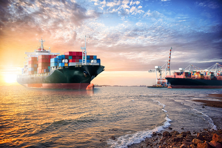 Logistics import export background of Container Cargo ship in the ocean at sunset sky, Freight Transportation