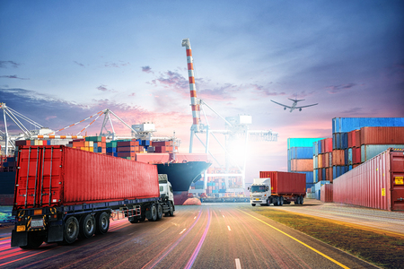 Logistics import export background and transport industry of Container Cargo freight ship at sunset sky