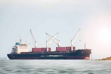 Logistics and Transportation of General Cargo ship in the ocean Stock Photo