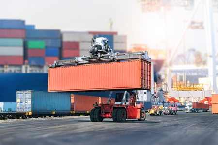 Logistics import export background and transport industry of forklift handling container box loading at port