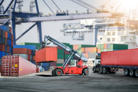 Logistics import export background and transport industry of forklift handling container box loading at port Stock Photo - 83008464