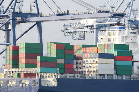 Logistics import export background of Container Cargo ship in seaport on blue sky, Freight Transportation