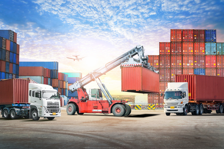Logistics import export background and transport industry of forklift handling container box loading at seaport Stock Photo