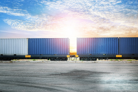 Industrial container yard at sunset sky for logistic import export background
