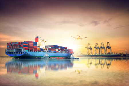 Logistics and transportation of International Container Cargo ship and cargo plane in the ocean at sunset sky, Freight Transportation, Shipping Banque d'images