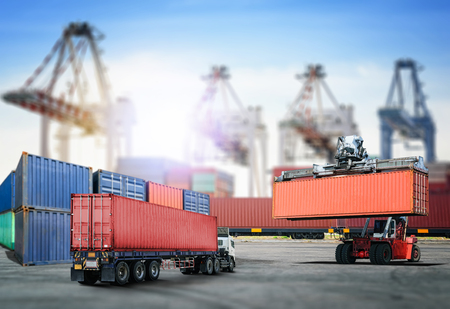Logistics import export background and transport industry of forklift handling container box loading at port Stock Photo - 83802530