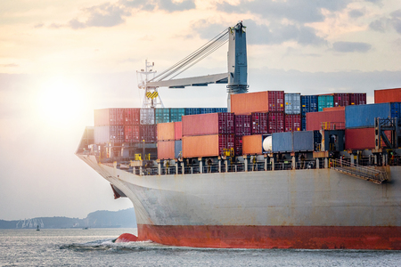 Logistics import export concept and transport industry of container cargo freight ship in the ocean at sunset sky, Freight transportation, Shipping Banque d'images
