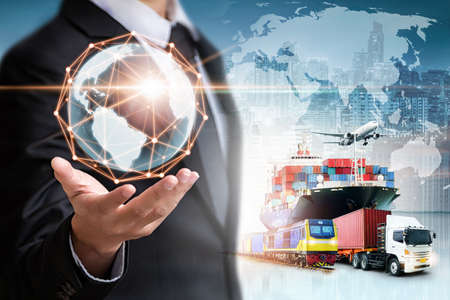Businessman holding digital globe in palm for logistics import export background and container cargo freight ship transport concept